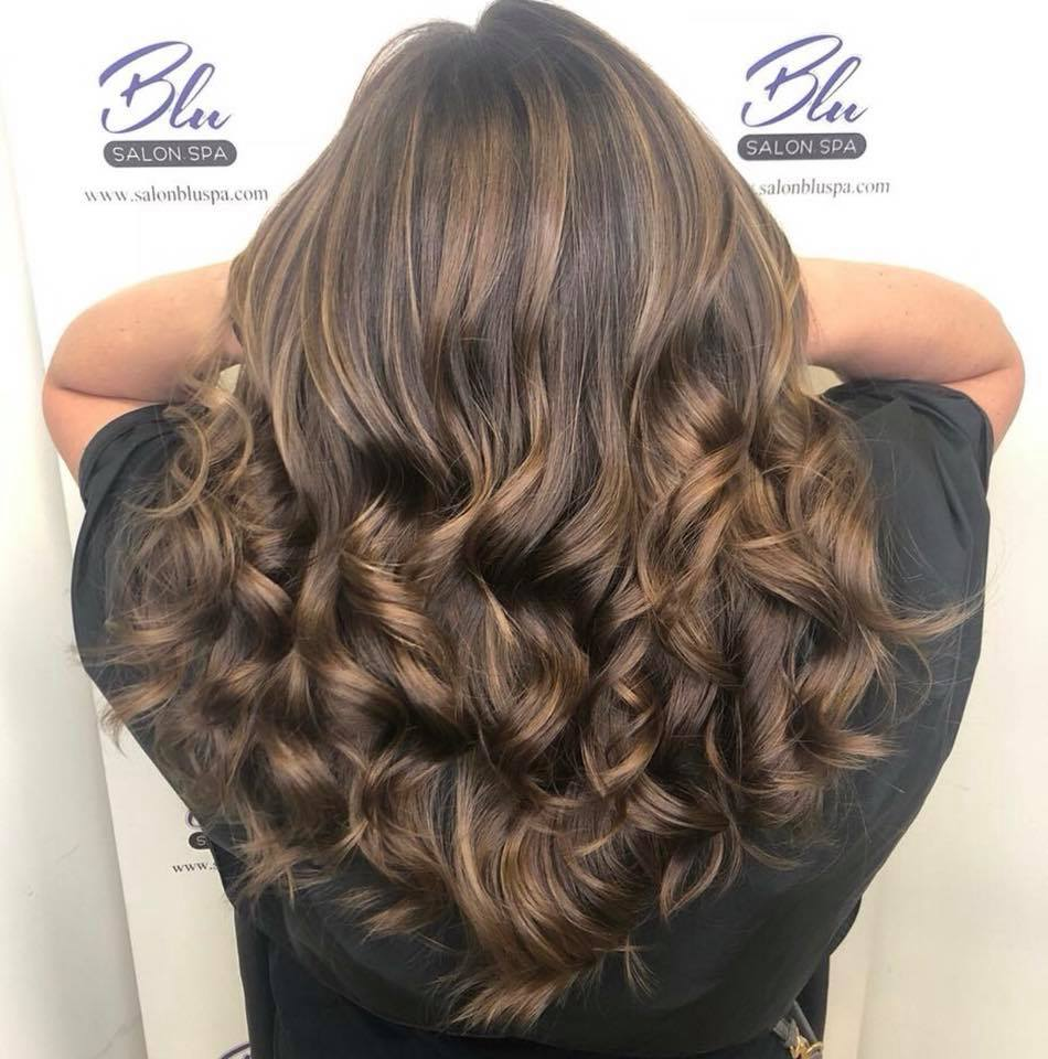 Long brunette hair with loose curls at ends
