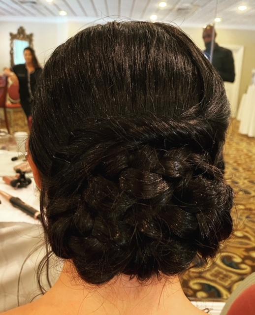 Braided brunette hair up in bun