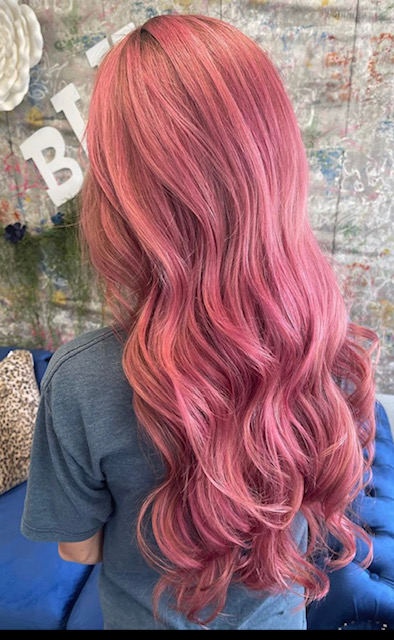 Lady with long wavy pink hair