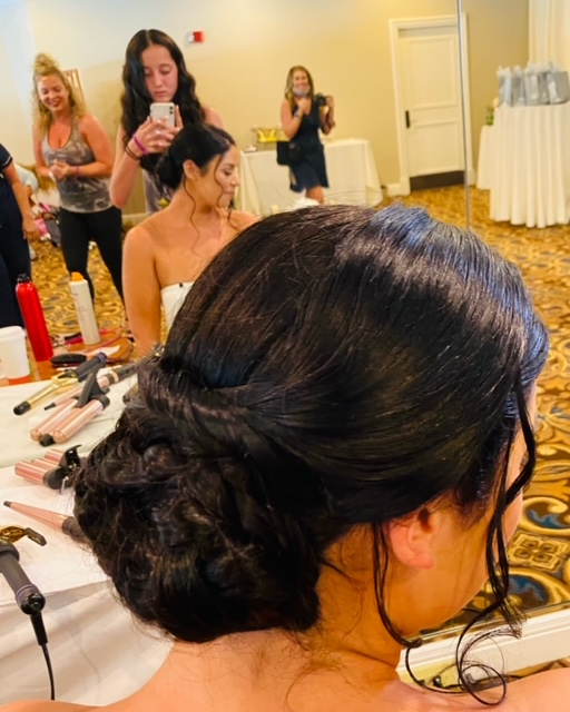 Side view of brunette with hair up in intricate bun