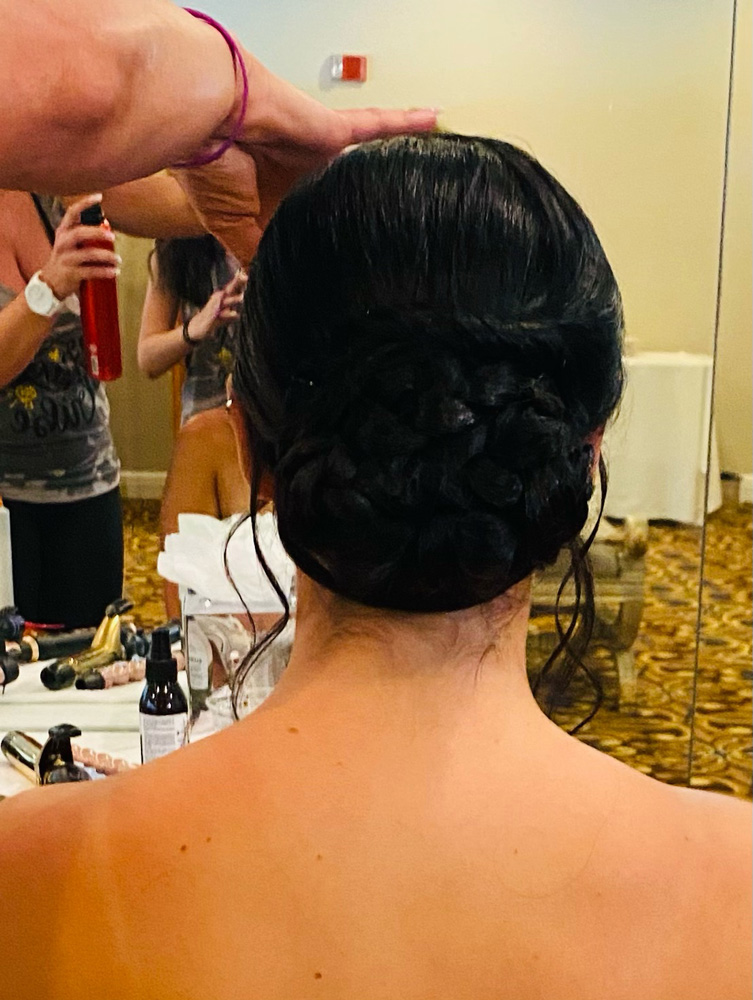 Black hair put up in braided bun