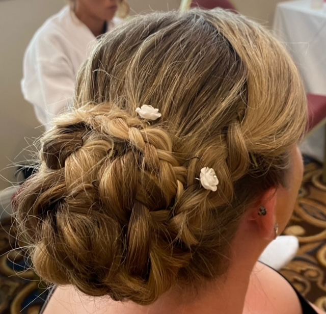 Braided dirty blond hair with flower clips