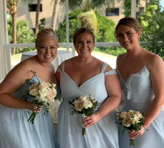 Three bridesmaids posing for photo in daylight